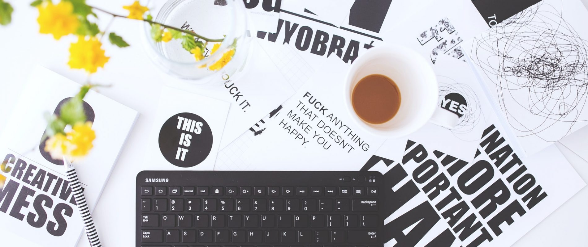 top-view-of-creative-workspace-with-keyboard-and-coffee-6463